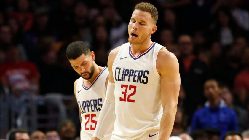 Clippers forward Blake Griffin (32) is injured late in the fourth quarter against the Lakers at Staples Center on Monday.