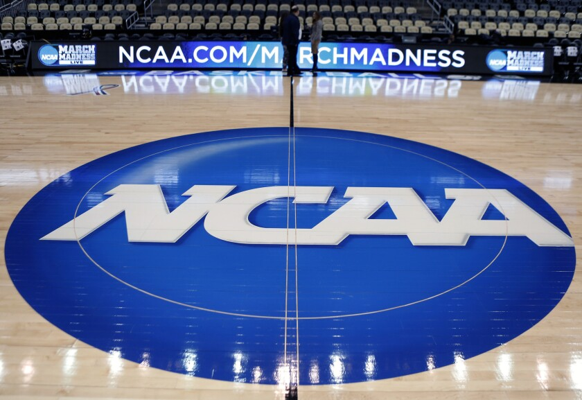 The NCAA logo at center court at the Consol Energy Center in Pittsburgh.