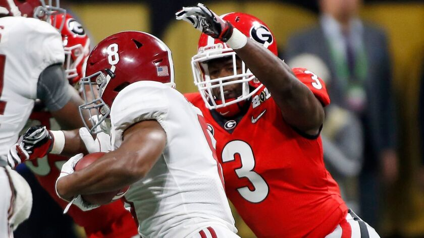 FILE - In this Jan. 8, 2018, file photo, Georgia linebacker Roquan Smith (3) goes in for a tackle on