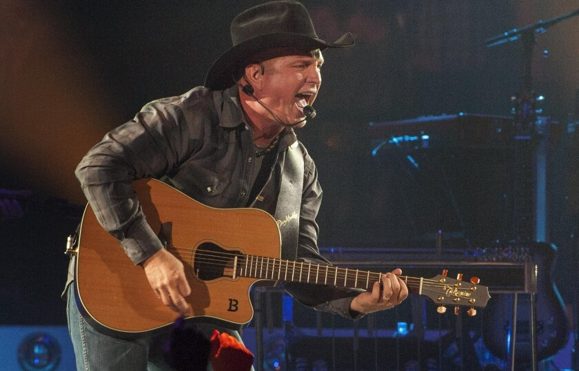Country music star Garth Brooks kicks off his Garth Brooks World Tour at the Allstate Arena in Rosemont, Ill., last year. The tour stops in San Diego for five shows tonight through Sunday at the Valley View Casino Center.