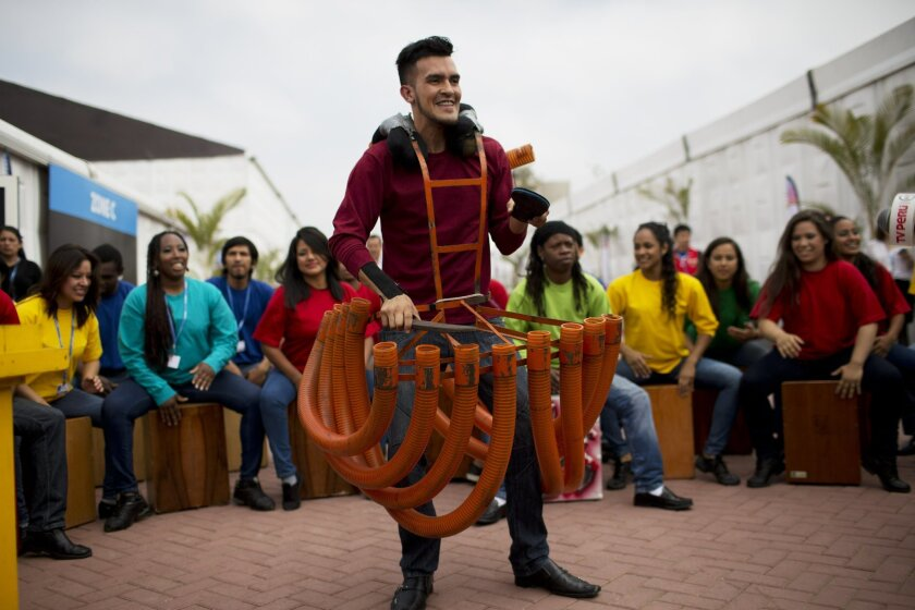 Artists perform during the inauguration of Climate Change Conference in Lima, Peru, Monday, Dec. 1, 2014. Delegates from more than 190 countries will meet in Lima for two weeks to work on drafts for a global climate deal that is supposed to be adopted next year in Paris. (AP Photo/Rodrigo Abd)