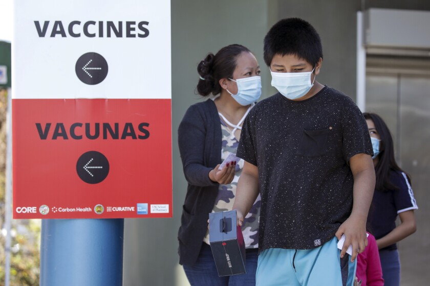 A child leaves a COVID-19 vaccination site.