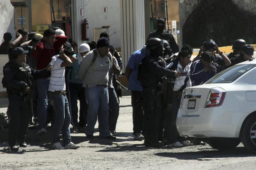 A group of trainee teachers are taken into custody after deadly clashes with police near the southern Mexican city of Chilpancingo on Dec. 12, 2011. The clashes occurred during a police attempt to clear a roadblock set up on a highway that runs from the central Mexican city of Cuernavaca to the Pacific resort city of Acapulco. EPA-EFE/STR/File