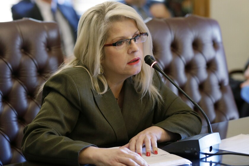 FILE - In this Jan. 28, 2015, file photo, Sen. Linda Collins-Smith, R-Pocahontas, speaks at the Arkansas state Capitol in Little Rock, Ark. A woman charged with killing the former Arkansas state lawmaker faces new charges alleging that she asked fellow inmates to kill the victim's ex-husband. Authorities on Tuesday, Jan. 14, 2019, charged Rebecca Lynn O'Donnell with two counts of criminal solicitation to commit capital murder and two counts of criminal solicitation to commit tampering with physical evidence. (AP Photo/Danny Johnston, File)