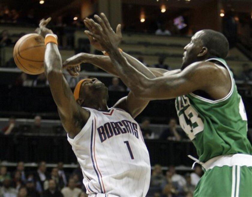 Boston Celtics' Kendrick Perkins (43) fouls Charlotte Bobcats' Stephen Jackson (1) in the first half of an NBA basketball game in Charlotte, N.C., Tuesday, Dec. 1, 2009. (AP Photo/Chuck Burton)