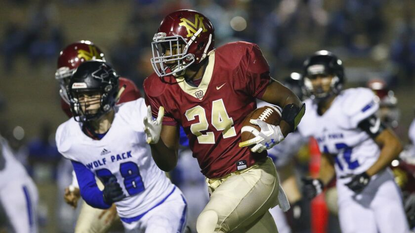 Monte Vista running back Jahmon McClendon (24) rushes in the first quarter against West Hills.