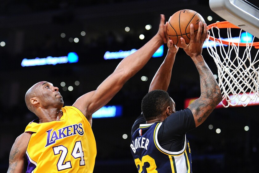 Kobe Bryant blocks a shot by Trevor Booker in his final game at Staples Center on Wednesday.