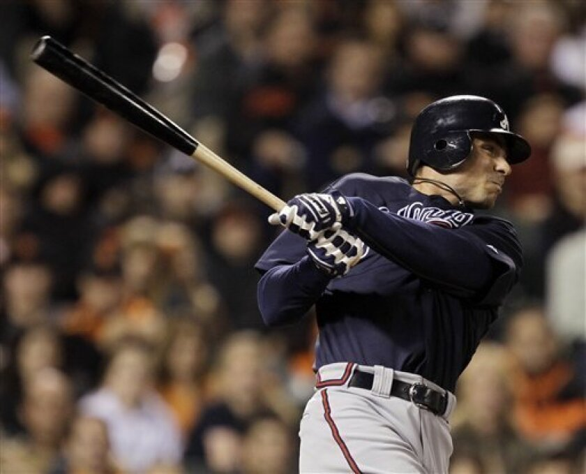 Atlanta Braves Rick Ankiel hits a solo home run in the eleventh inning of Game 2 of the National League Division Series baseball game against the San Francisco Giants in San Francisco, Friday, Oct. 8, 2010. (AP Photo/Marcio Jose Sanchez)