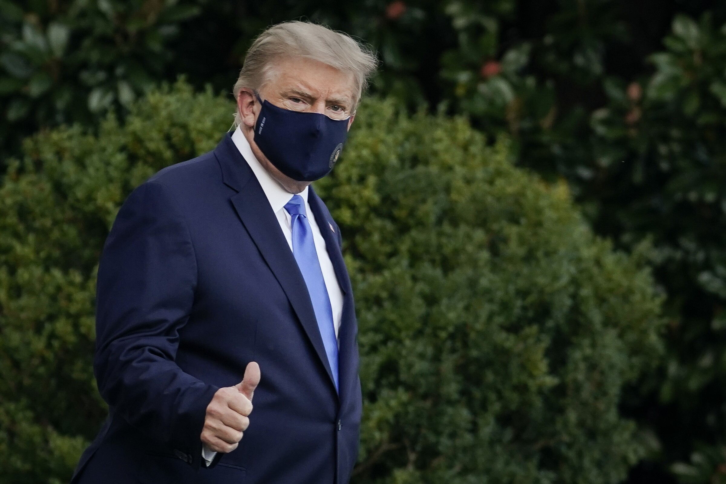 President Trump wearing a mask and flashing a thumbs-up
