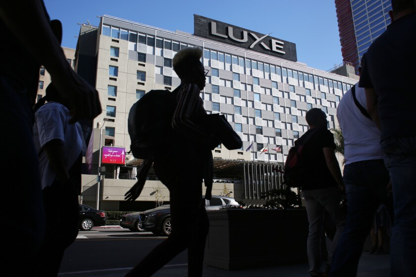 LOS ANGELES, CA-MARCH 14, 2019: People walk by The Luxe City Center Hotel which has been a favorite