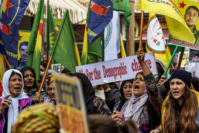 Kurds protest against Turkey in the northeastern Syrian city of Qamishli.