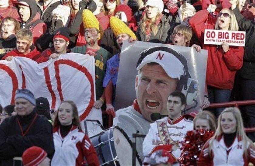 Nebraska fans hold up a poster of Nebraska head coach Bo Pelini, prior to an NCAA college football game against Colorado, in Lincoln, Neb., Friday, Nov. 26, 2010. (AP Photo/Nati Harnik)