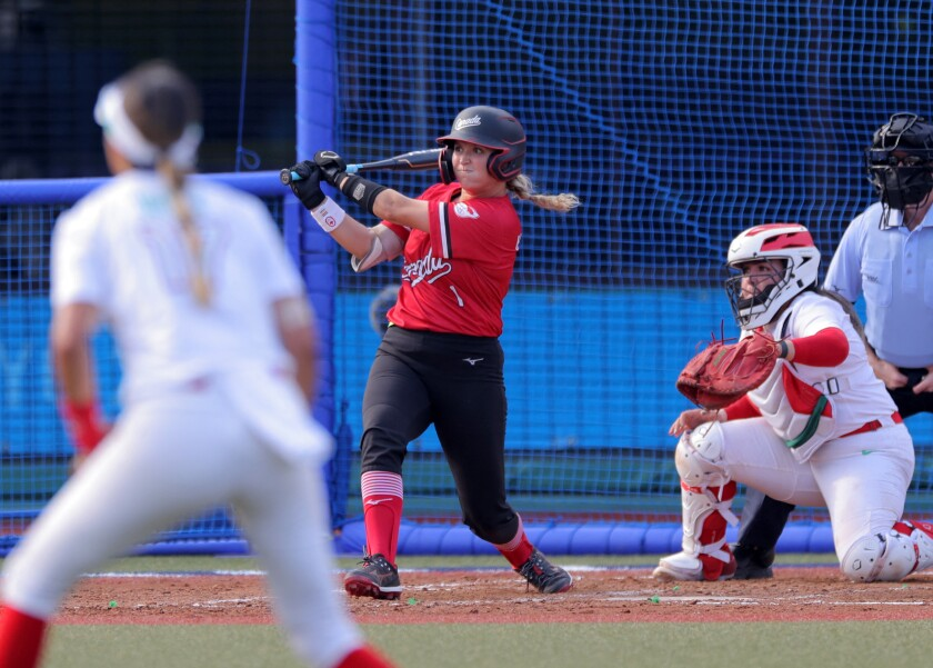 Canada's Kelsey Harshman (C) hits an RBI single during the 4th inning of the Tokyo 2020 Olympic Games
