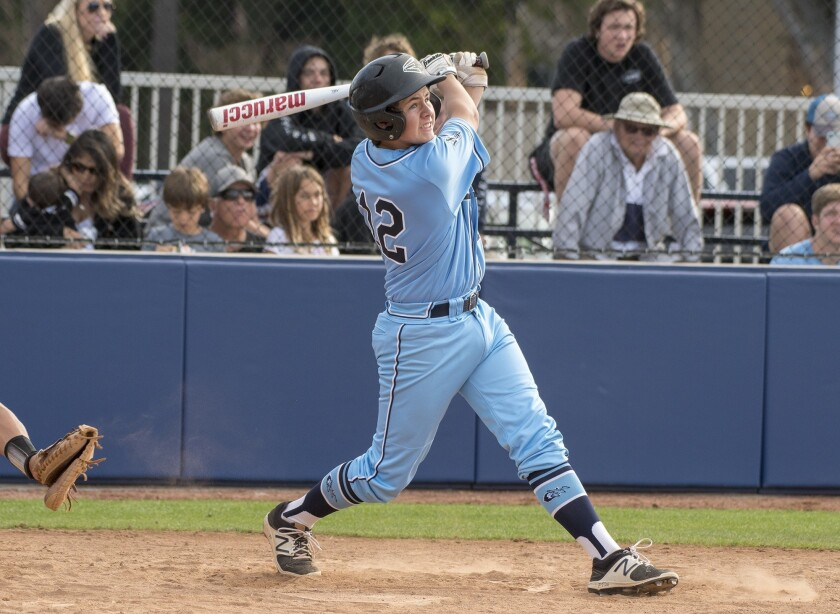 Corona del Mar's Kieran Sidebotham hits a single in the fifth inning during a Pacific Coast League g