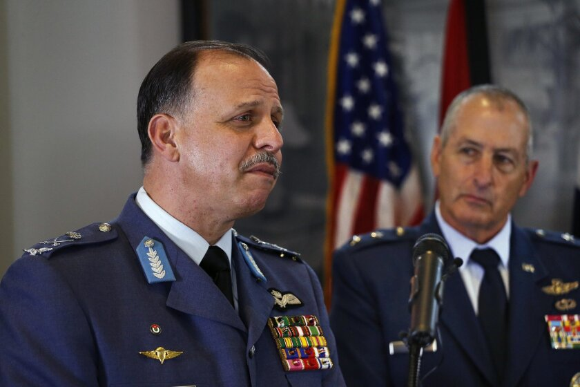 Lt. General Prince Feisal bin Al-Hussein of Jordan, left, stands with Colo. National Guard Commander Maj. General H. Michael Edwards, as he listens to questions from members of the media during a news conference at the Governor's Mansion, in Denver, Thursday Sept. 11, 2014. The event marked ten years of military cooperation in the Colorado-Jordan State Partnership Program. (AP Photo/Brennan Linsley)