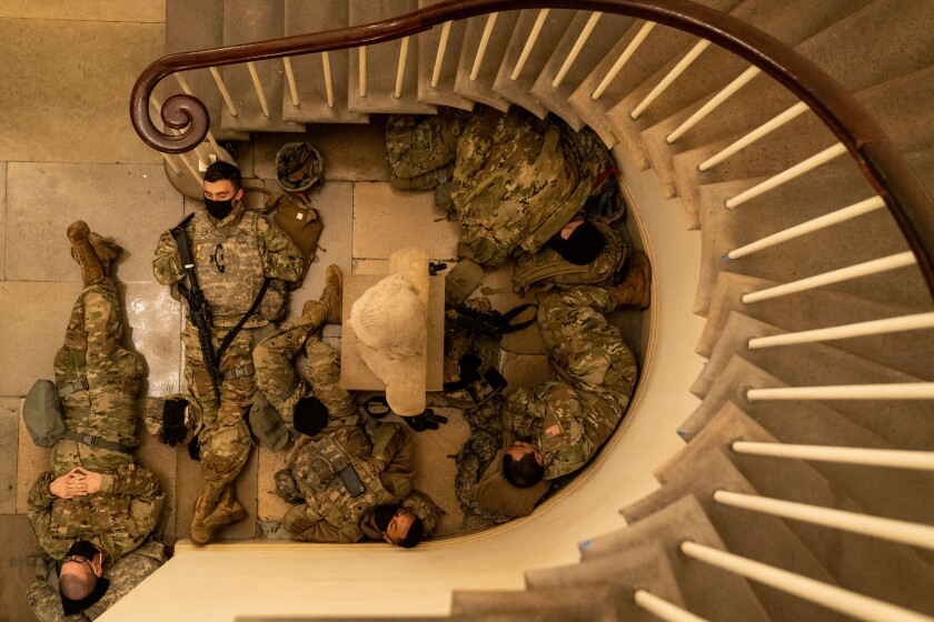 Members of the National Guard sleep in the halls of the Capitol.