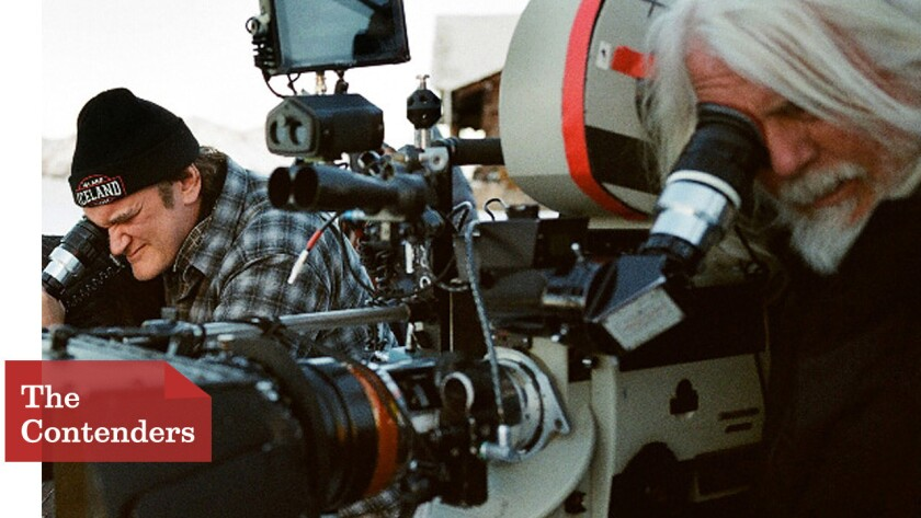 """Quentin Tarantino, left, and cinematographer Robert Richardson line up a shot on the set of """"The Hateful Eight."""""""
