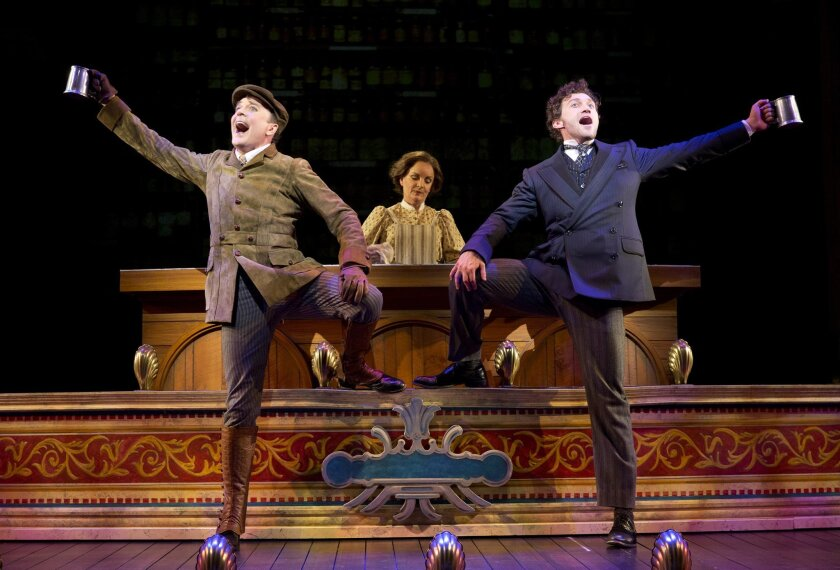 """This image released by the The O+M Co. shows, from left, Jefferson Mays as Henry D'Ysquith, Jennifer Smith, and Bryce Pinkham as Monty Navarro in a scene from """"A Gentleman's Guide to Love and Murder."""" The production was nominated for 10 Tony Awards, which will be held on Sunday, June 8, 2014 in New York. (AP Photo/The O+M Co., Joan Marcus)"""