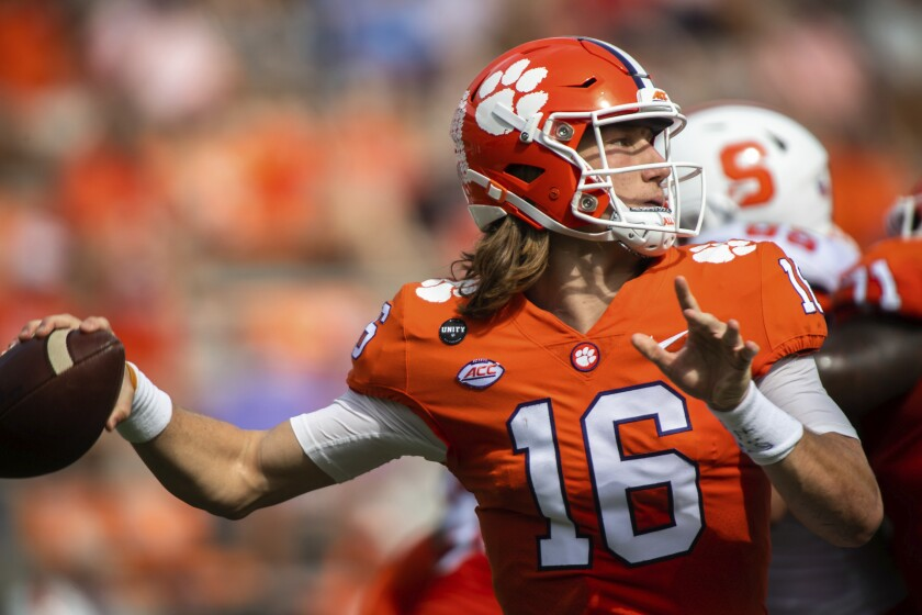 Clemson quarterback Trevor Lawrence makes a pass against Syracuse.