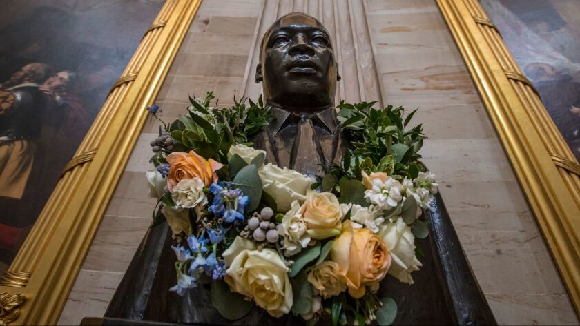 The bust of civil rights activist and leader Martin Luther King Jr. is draped with a wreath of flowers in the Capitol Rotunda in Washington on Jan. 11.