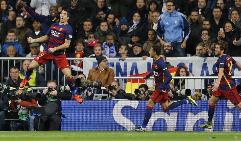 Barcelona's Luis Suarez celebrates after scoring the opening goal during the first clasico of the season between Real Madrid and Barcelona at the Santiago Bernabeu stadium in Madrid, Spain, Saturday, Nov. 21, 2015. (AP Photo/Francisco Seco)