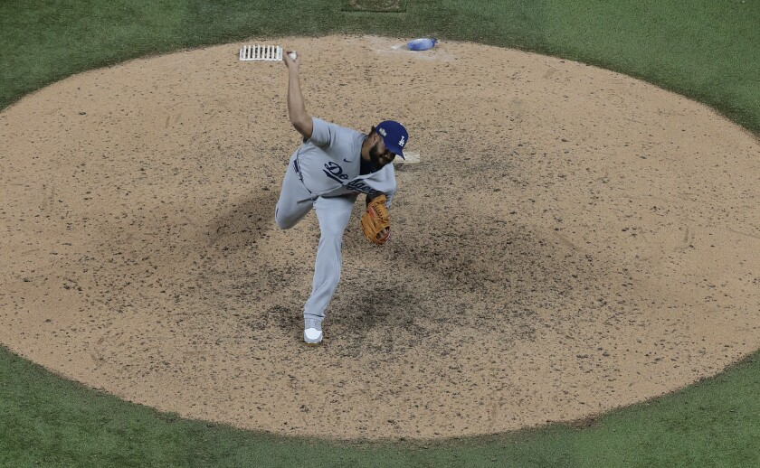 Dodgers reliever Kenley Jansen delivers a pitch during the ninth inning of a 7-3 win over the Atlanta Braves.