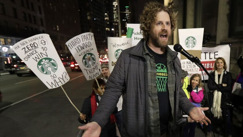 """Jason Reid, director of the """"Sonicsgate"""" documentary film, speaks during a protest outside a book-pr"""