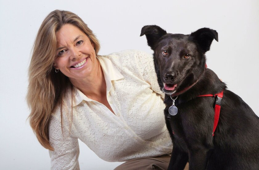 Portrait of Encinitas resident Britta Wilson and her dog, Shelby.