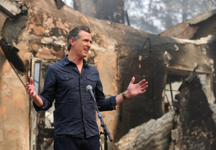 FILE - In this Oct. 1, 2020, file photo, California Governor Gavin Newsom speaks at a press conference while touring areas damaged by the Glass Fire at Foothills Elementary School near St. Helena, Calif. On Tuesday, March 30, 2021, Gov. Newsom announced the state will hire nearly 1,400 additional firefighters as dry weather portends a troubling wildfire season. (Christopher Chung/The Press Democrat via AP, Pool, File)
