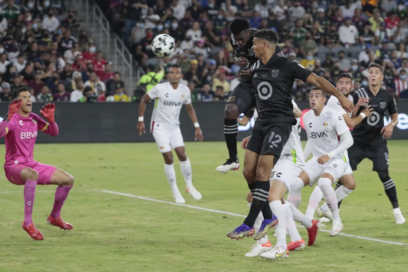 MLS' Jesus Murillo scores on a header past Liga MX goalkeeper Alfredo Talavera during the MLS All-Star Game