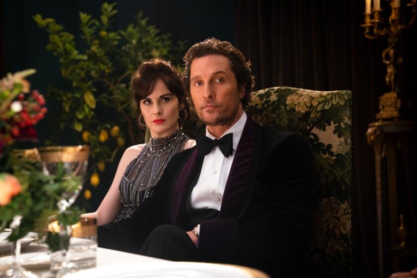 "Michelle Dockery and Matthew McConaughey in the movie ""The Gentlemen."""