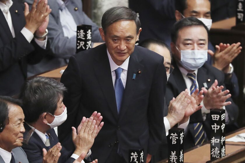 Yoshihide Suga is applauded after being elected Japan's new prime minister.