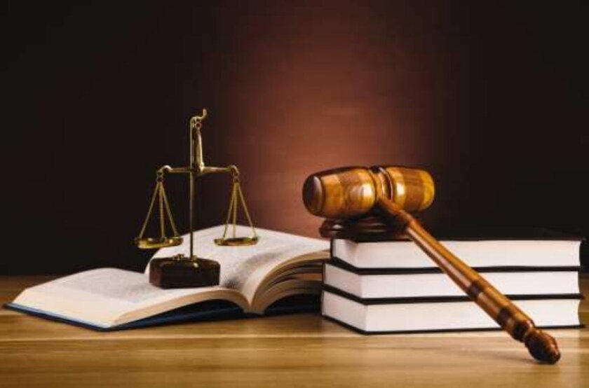 Law books, gavel and scales of justice