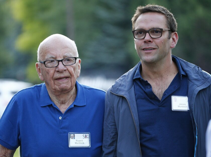 Time Warner rejected Fox's $80-billion bid for the company in part because Fox offered non-voting shares, which would keep the Murdoch family in control. Above, Rupert Murdoch, left, and son James.