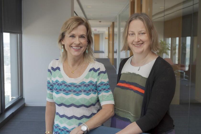 Stephanie Shubat (left) and Gail Karet of the U.S. Adopted Names program