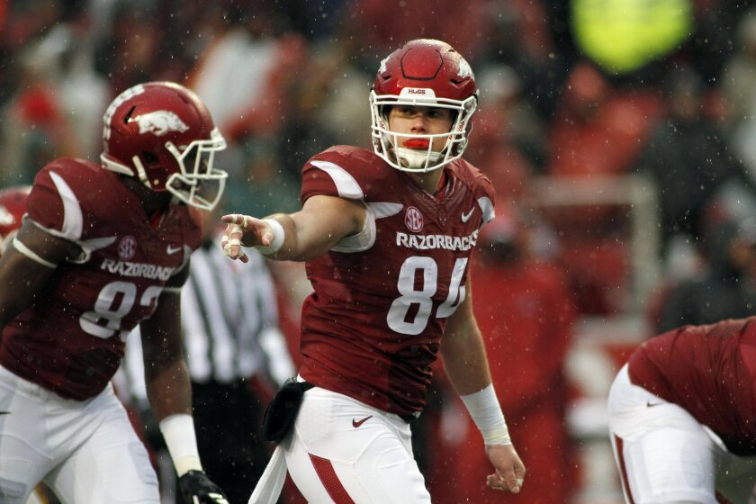 FILE - In this Nov. 27, 2015, file photo, Arkansas' Hunter Henry (84) points to his teammate during the first half of an NCAA college football game against Missouri in Fayetteville, Ark. The way the spread offense has taken over college football has made the NFL draft even more of a crapshoot. In the past, pro scouts had seen college prospects perform in something similar to the NFL. (AP Photo/Samantha Baker, File0