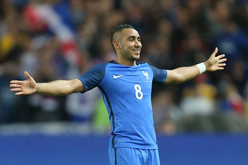 France's Dimitri Payet jubilates after scoring his team's third goal during a friendly soccer match between France and Cameroon at the La Beaujoire Stadium in Nantes, western France, Monday, May 30, 2016. The French squad is in preparation for the EURO 2016 soccer championships which start on June