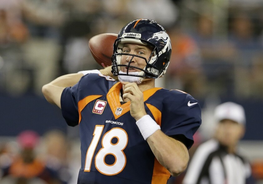 Denver Broncos quarterback Peyton Manning passes with under two minutes to go in the fourth quarter of an NFL football game against the Dallas Cowboys on Sunday.