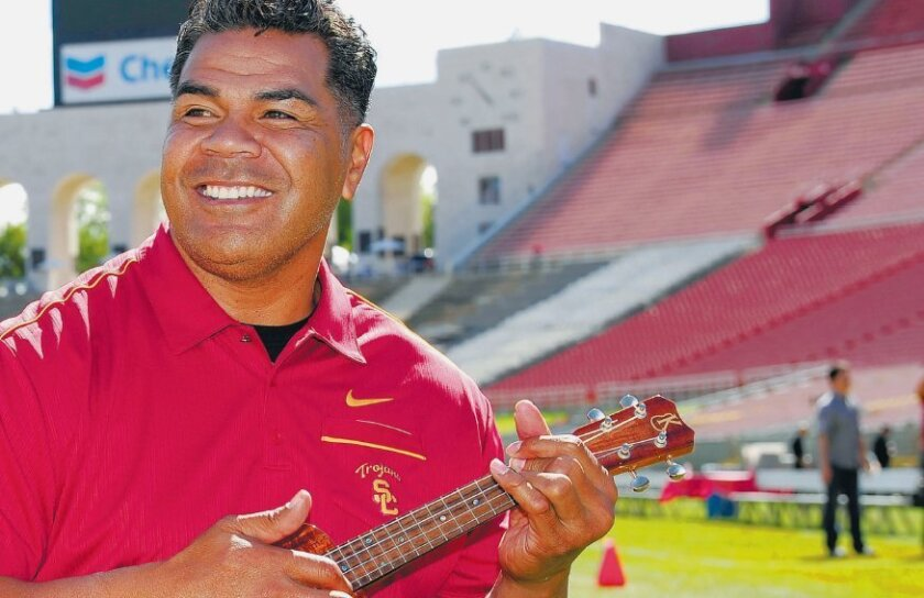 Seau at a USC event in Los Angeles on April 14, less than three weeks before his death.