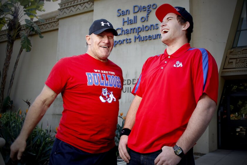 Steve Hendrickson and son Kyle, who will play football for Fresno State, attended the signing day event at the Hall of Champions.