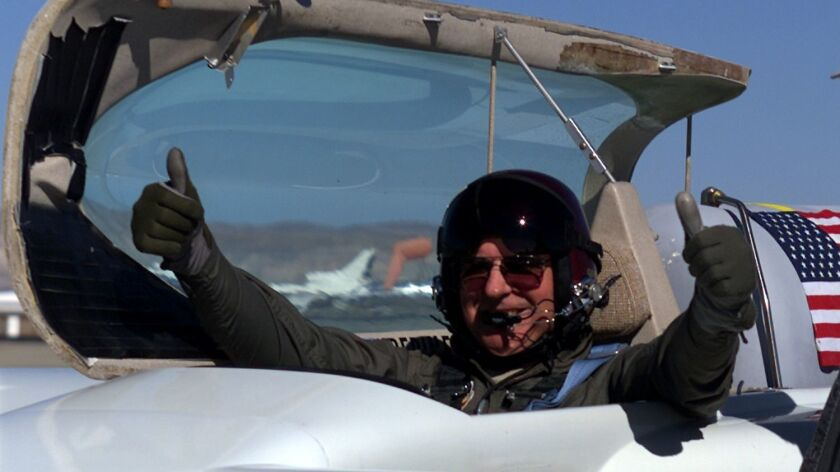 Dick Rutan, who was Xcor Aerospace's chief test pilot at the time, gives a thumbs up after a success