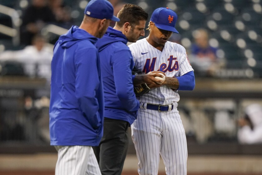 New York Mets starting pitcher Marcus Stroman speaks to staff during the second inning of a baseball game against the Atlanta Braves Tuesday, June 22, 2021, in New York. (AP Photo/Frank Franklin II)