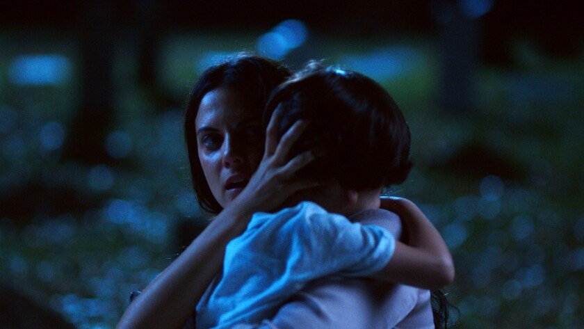 """(L-R) - Melina Matthews as 'Anna' hugging her son in a scene from """"Silencio."""" Credit: Tulip Pictures"""