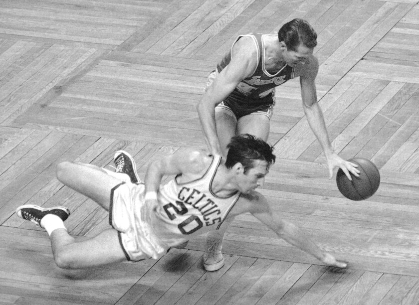 FILE - In this April 30, 1968, file photo, Boston Celtics' Larry Siegfried (20) dives after a loose