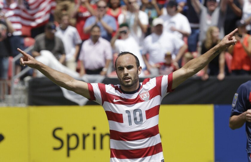 FILE - In this July 13, 2013, file photo, United States' Landon Donovan gestures after scoring on a penalty kick during the first half of a CONCACAF Gold Cup soccer game against Cuba in Sandy, Utah. Donovan will be surrounded by a relatively youthful roster for the United States' exhibition against Ecuador in Connecticut on Friday, when he is set to make his 157th and final international appearance. (AP Photo/Rick Bowmer, File)