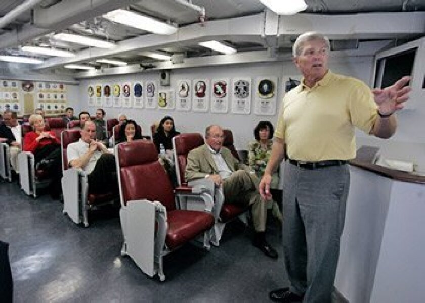 """Six of the original 1969 TOPGUN flight instructors were aboard the USS Midway Museum yesterday for a """"ready room"""" dedication and panel discussion. Darrell Gary (right) unveiled an honorary plaque.  (Crissy Pascual / Union-Tribune)"""