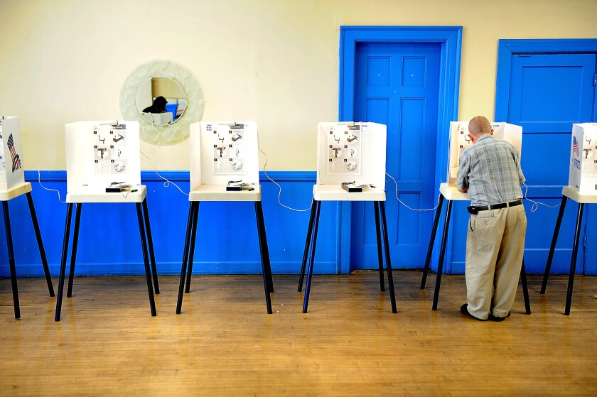 A man votes at St. Anthony Grand Lodge in South Los Angeles last November.