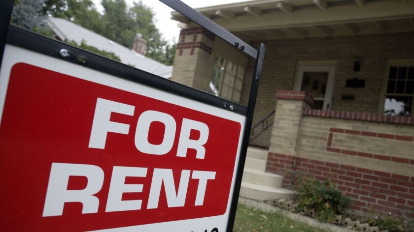 """FILE - In this Sept. 24, 2007 file photo, a """"for rent"""" sign is posted outside a home in Denver. Rea"""