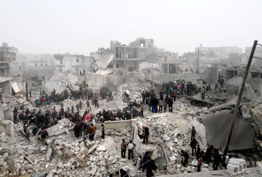 A photo provided by the Syrian opposition shows people in Aleppo inspecting the damage after an apparent surface-to-surface missile strike on the city.