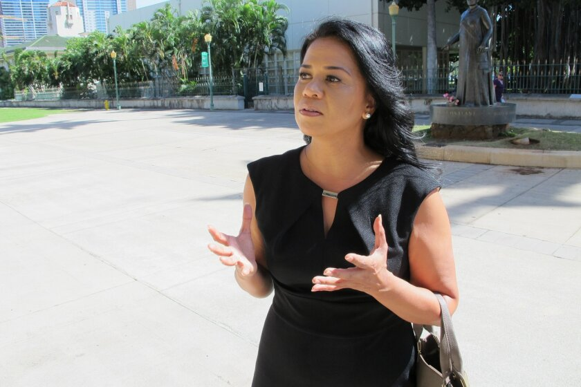 Piilani Smith talks about a bill that would help unmarried or same-sex couples and single women greater access to fertility treatments on Monday, April 27, 2015, in Honolulu. Hawaii mandates insurance coverage for in vitro fertilization, but the rule only applies to heterosexual, married couples. (